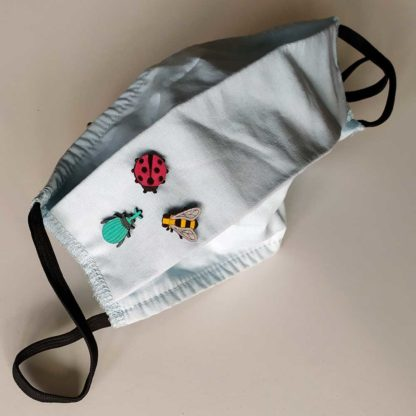 Bijoux de masque en bois insectes