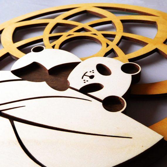 panda endormi sur plume